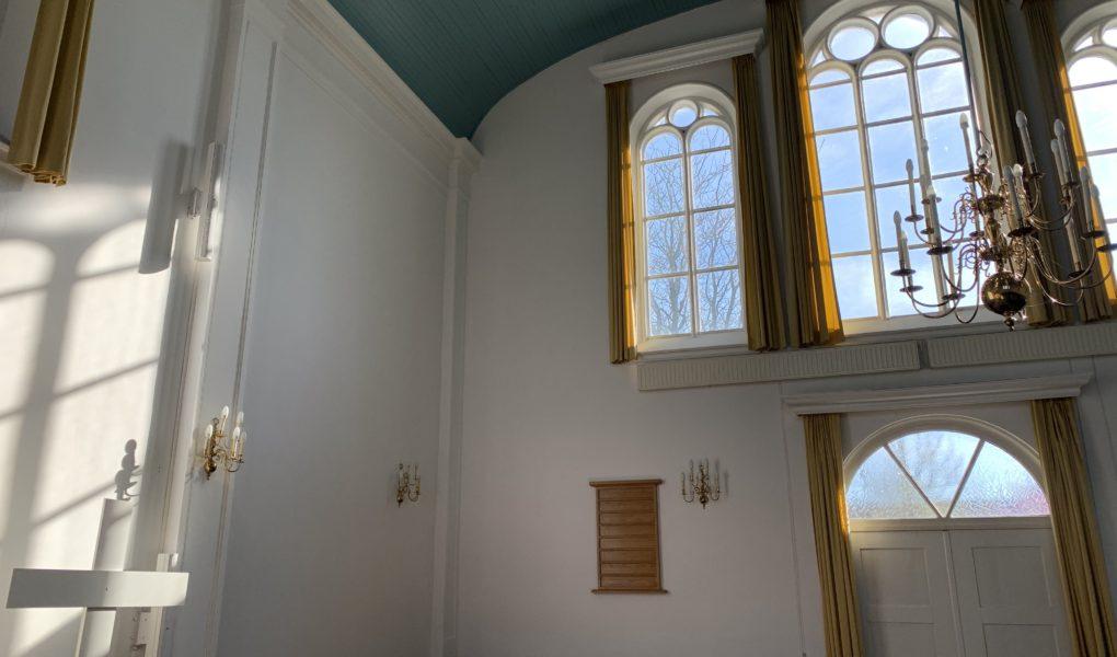 Afbeelding van een kerkgebouw bij een blog over Corona en de kerk