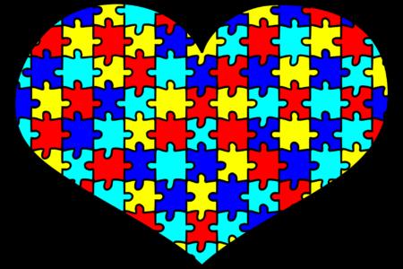 hart met puzzelstukken bij een blog over autisme in de kerk